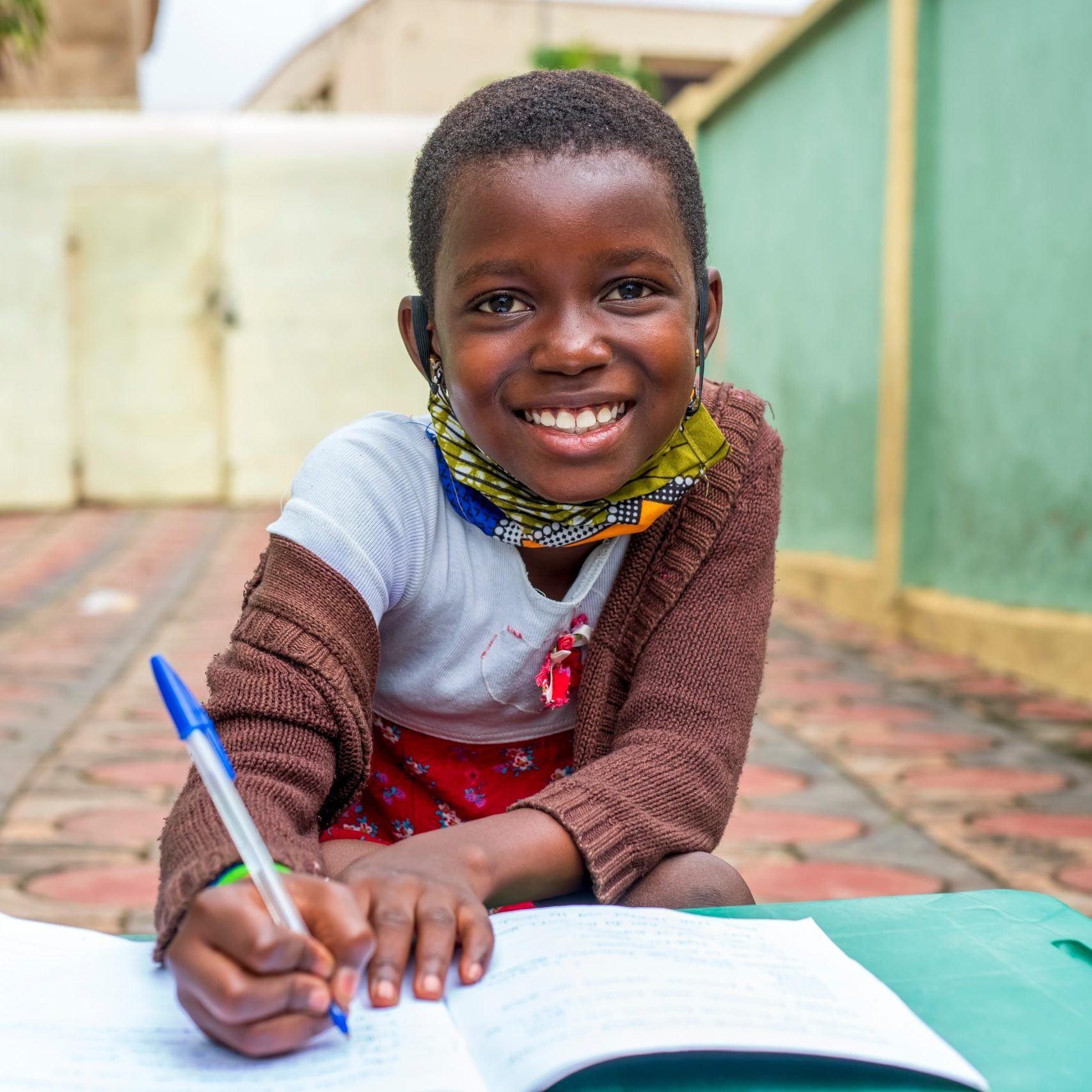 Close-up,Shot,Of,An,African,School,Girl,Smiling,,Studying,wearing,Homemade