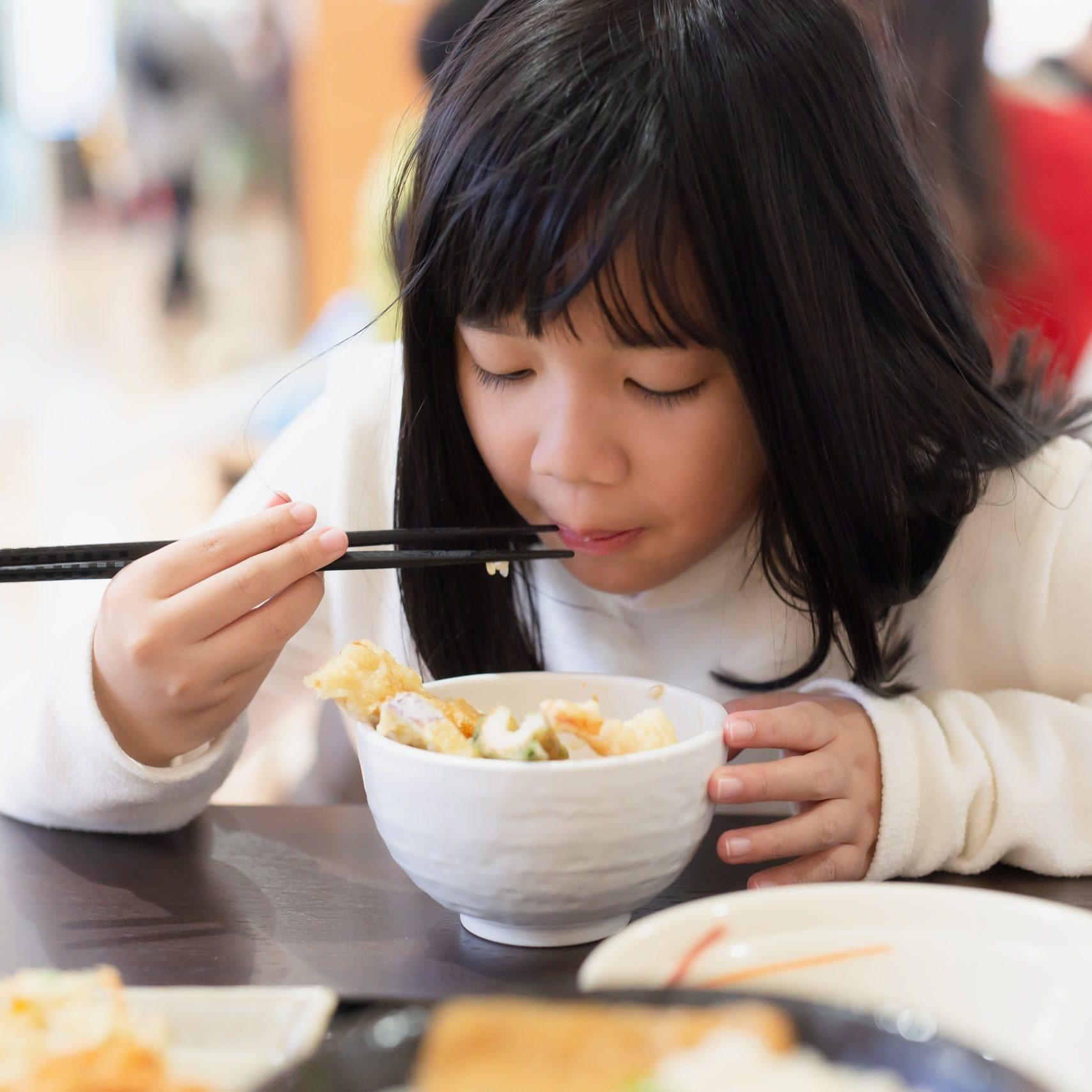Asian,Girl,Girl,Eating,Tempura,Shrimp,With,Chopsticks